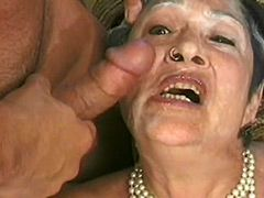 Granny babe removes glasses and gives blowjob