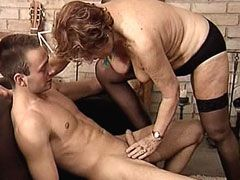 Granny in black stockings rides fresh young dick