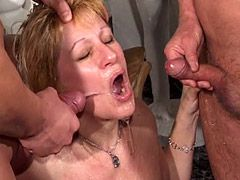 Sexy mature bitch gets pissing in wild group sex