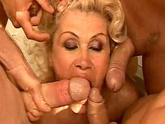 Blonde granny gets cream on face after wild ganbang