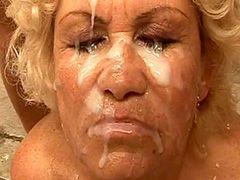 Blonde granny gets cream on face after wild ganbang