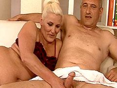 Blonde mature bitch gets fucked on bed..