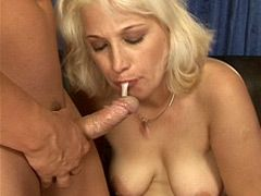Blonde mature with tattoo on belly gets hard cock