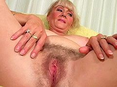 Hairy mature whore banged by..
