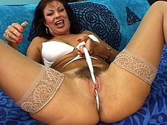 Hairy mature in brown stockings jump big snake