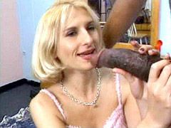 Blonde mature jerks big black dick and gets facial cumshot