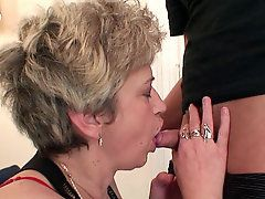 Threesome with a mature slut taking her husbands cock and..