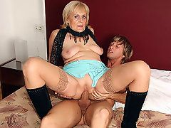 Hot granny hooker is hired by a young man to fuck his..