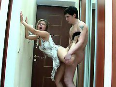 Dolled-up milf caught by a horny just from the shower guy..