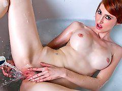 Redhead milf soapy pussy playStunning redhead milf climbs..