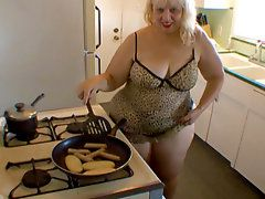 MILF sexy cooking time!Join this mature woman in her..